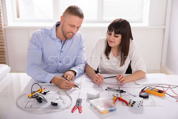 Male And Female Architect Working On Blueprint Stock photo © AndreyPopov