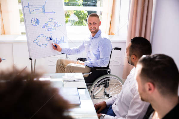 Disabled Businessman Giving Presentation Stock photo © AndreyPopov