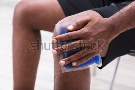 Man Applying Ice Gel Pack On His Knee Stock photo © AndreyPopov