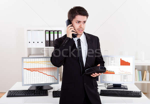 Worried stock broker on the phone Stock photo © AndreyPopov