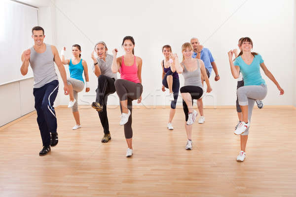 Group of people doing aerobics exercises Stock photo © AndreyPopov