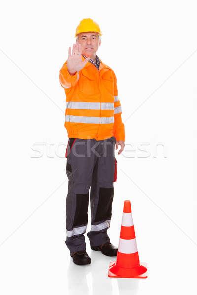 Man tonen stopteken witte werk oranje Stockfoto © AndreyPopov