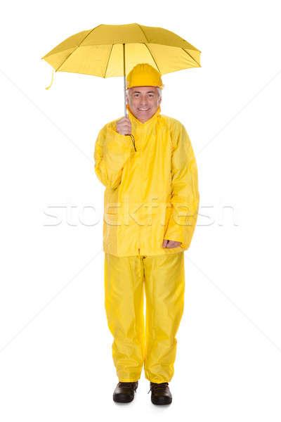 érett férfi visel esőkabát tart esernyő fehér Stock fotó © AndreyPopov