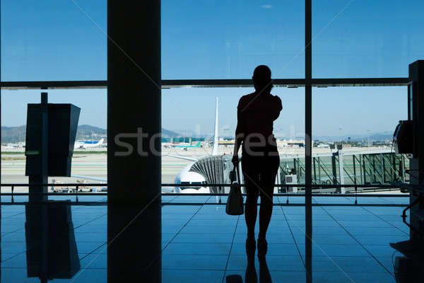 Silhouette of women in airport terminal Stock photo © AndreyPopov