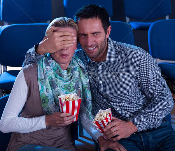 Couple watching a movie reacting in horror Stock photo © AndreyPopov