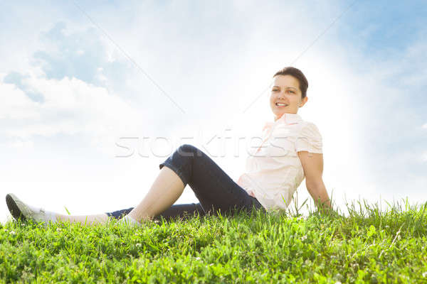 Young Woman Relaxing In Grassland Stock photo © AndreyPopov