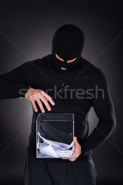 Criminal trying to access ballot box Stock photo © AndreyPopov