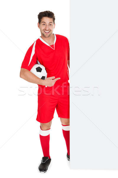 Soccer Player Pointing At Billboard Stock photo © AndreyPopov