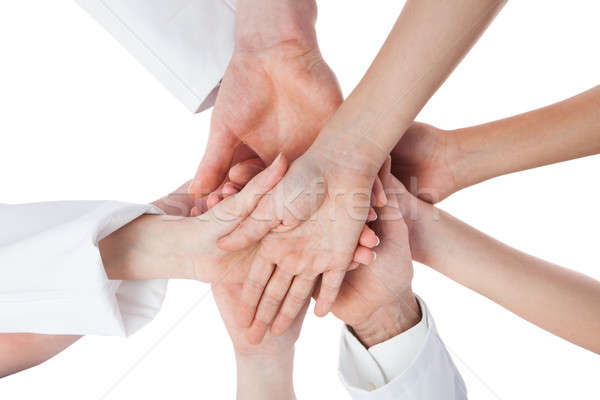 Doctors and nurses stacking hands Stock photo © AndreyPopov