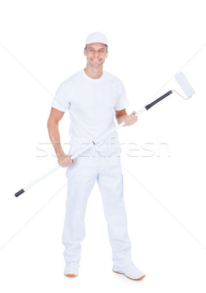 Painter Holding Paint Roller Stock photo © AndreyPopov