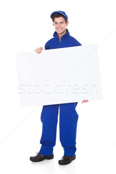Male Worker Holding Blank Placard Stock photo © AndreyPopov