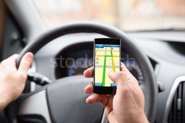 Man Using Gps In Cellphone While Driving Stock photo © AndreyPopov