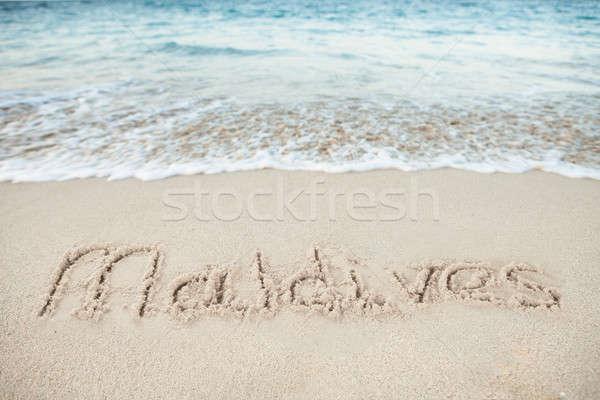 Maldive scritto sabbia mare spiaggia estate Foto d'archivio © AndreyPopov