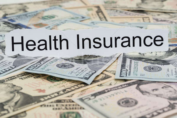 Health Insurance Text On Piece Of Paper Stock photo © AndreyPopov