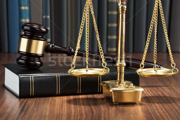 Gavel On Book With Golden Scale Stock photo © AndreyPopov