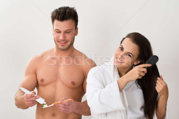 Man Holding Tooth Brush And Her Wife Combing Her Hair Stock photo © AndreyPopov