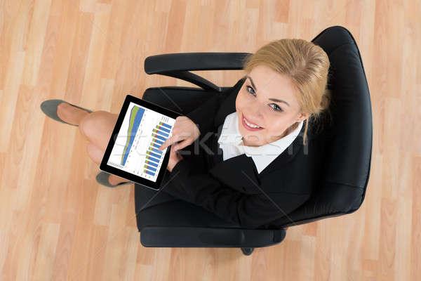 Işkadını oturma ofis koltuğu dijital tablet mutlu Stok fotoğraf © AndreyPopov