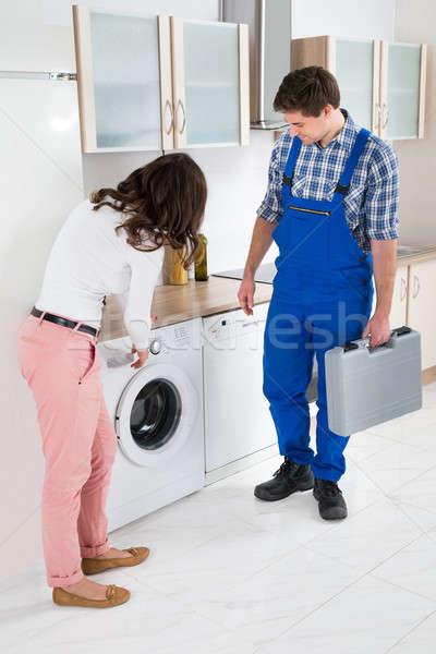 Kadın zarar çamaşır makinesi genç kadın Stok fotoğraf © AndreyPopov