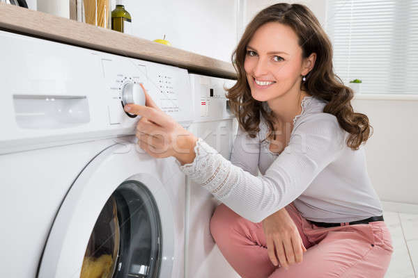 Woman Pressing Button Of Washing Machine Stock photo © AndreyPopov