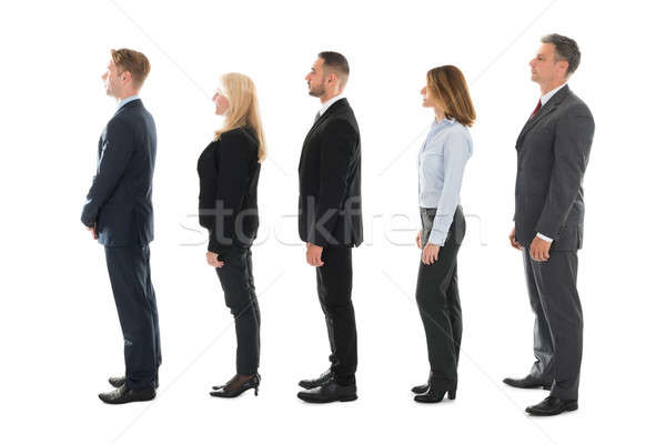 Side View Of Business People Standing In Row Stock photo © AndreyPopov