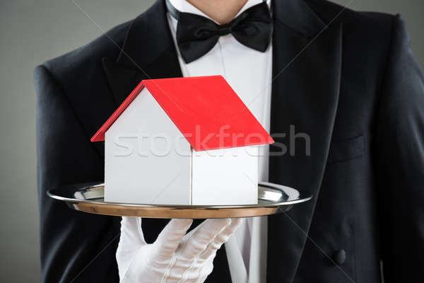 Midsection Of Waiter Holding House Model In Tray Stock photo © AndreyPopov