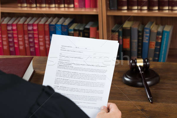 Peachy Judge Reading Legal Documents At Desk In Courtroom Stock Interior Design Ideas Inesswwsoteloinfo