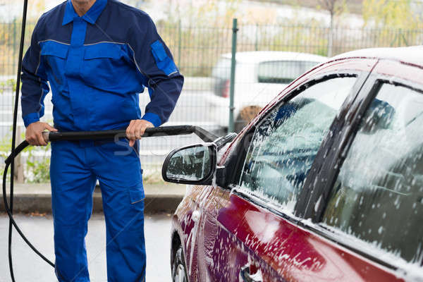 Serviceman Washing Car With Brush At Service Station Stock photo © AndreyPopov