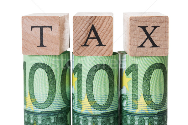Tax Blocks Arranged On Rolled Euro Notes Stock photo © AndreyPopov