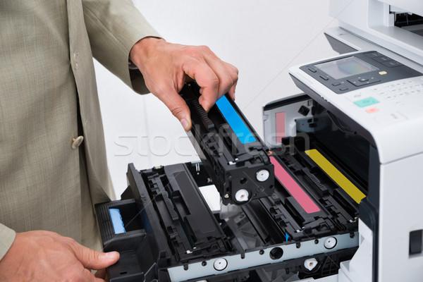 üzletember megjavít patron gép kép iroda Stock fotó © AndreyPopov