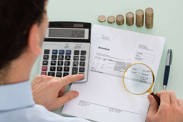 üzletember megvizsgál számla fotó könyvvizsgáló nagyító Stock fotó © AndreyPopov
