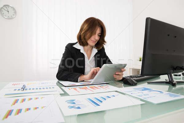 Businesswoman Working On Digital Tablet Stock photo © AndreyPopov