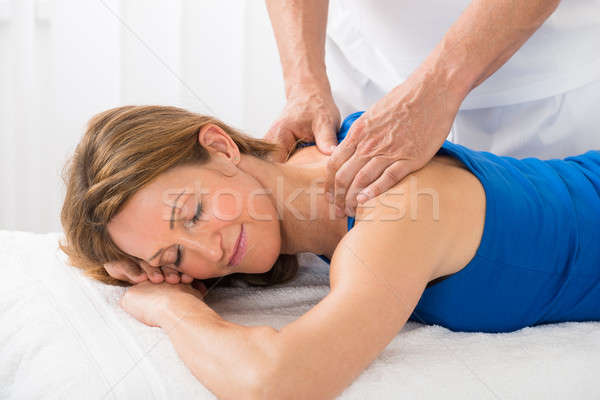 Person Giving Massage To Woman Stock photo © AndreyPopov