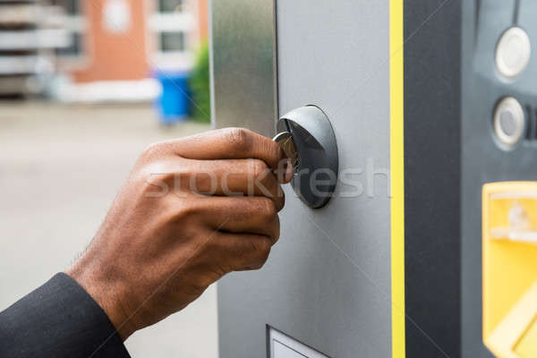 Person's Hand Inserting Coin Into Parking Meter Stock photo © AndreyPopov