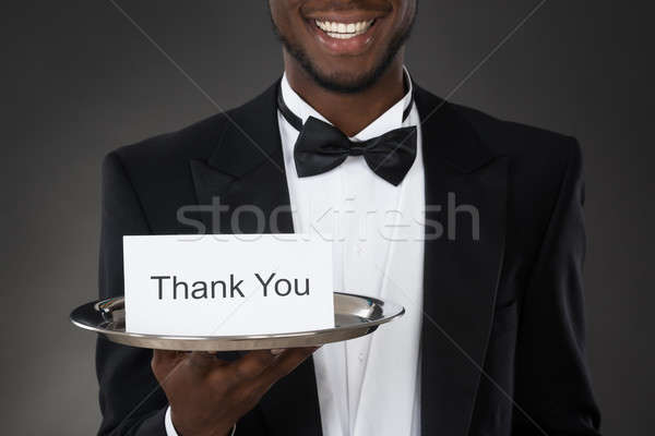 Stock photo: Waiter Holding Thank You Card In Tray