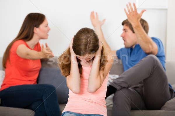 Chateado menina pai ou mãe argumento orelhas família Foto stock © AndreyPopov