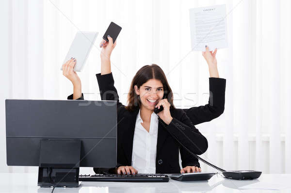 Stock photo: Busy Businesswoman Multitasking