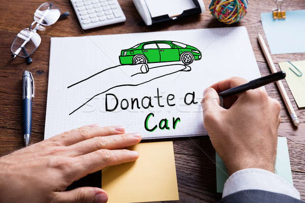 Businessperson Drawing Concept Of Car Donation On Notebook Stock photo © AndreyPopov