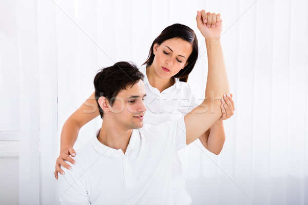 Masseur Giving Massage To Man Stock photo © AndreyPopov