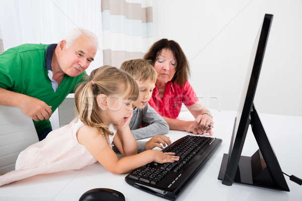 Multi Generation Family Using Desktop At Home Stock photo © AndreyPopov
