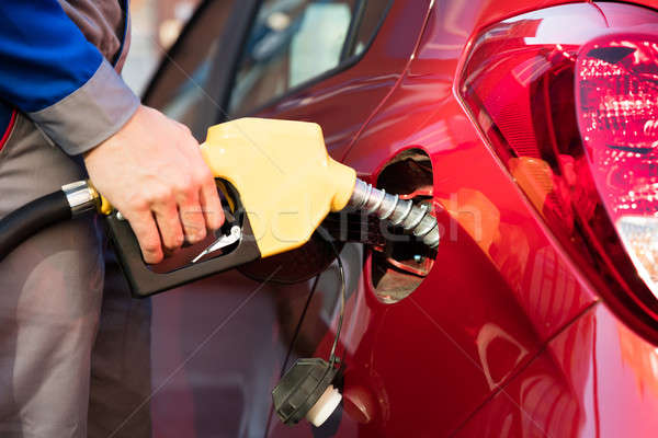 Person's Hand Refueling Car's Tank Stock photo © AndreyPopov