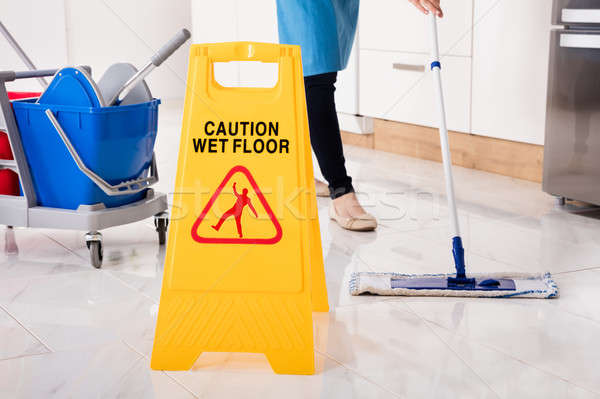Yellow Wet Caution Sign On Wet Floor In Kitchen Stock photo © AndreyPopov