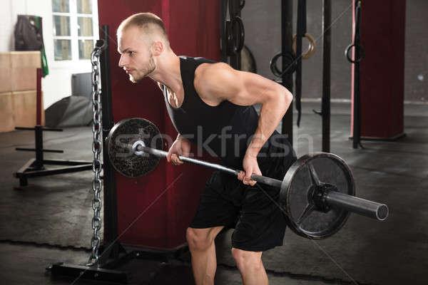 Man Lifting Barbell Stock photo © AndreyPopov