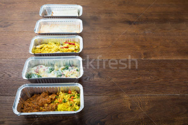 Row Of Take Away Dishes On Wooden Table Stock photo © AndreyPopov