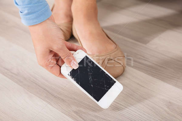 Woman Picking Up The Broken Smart Phone Stock photo © AndreyPopov