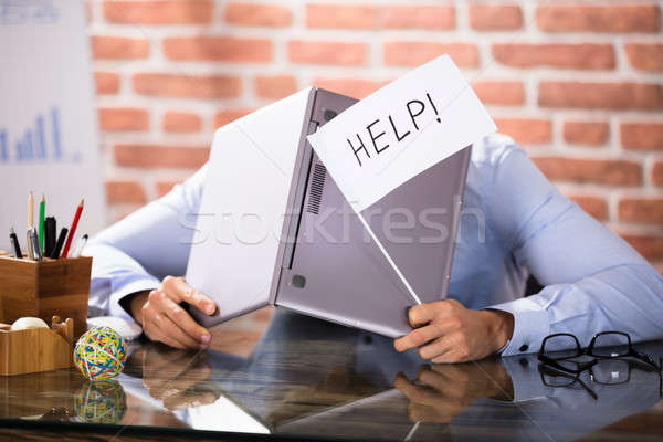 Businessman Covering His Head With Laptop Asking Help Stock photo © AndreyPopov