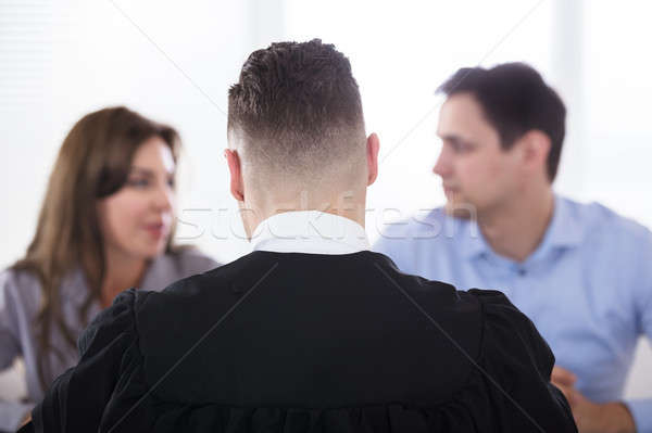 Casal juiz masculino sessão homem Foto stock © AndreyPopov