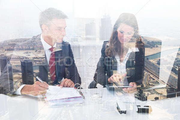 Colegas de trabajo escritorio ciudad doble exposición Foto stock © AndreyPopov