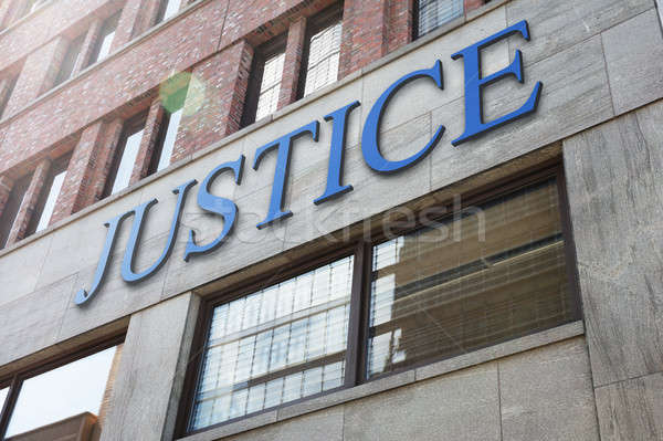 Justice sign on modern building in city Stock photo © AndreyPopov