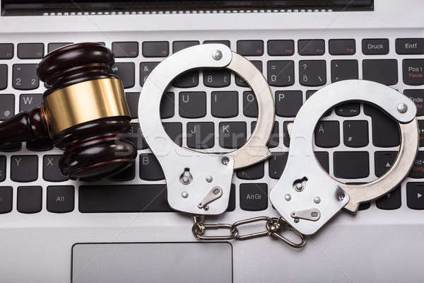 Handcuffs And Gavel On Laptop Keyboard Stock photo © AndreyPopov