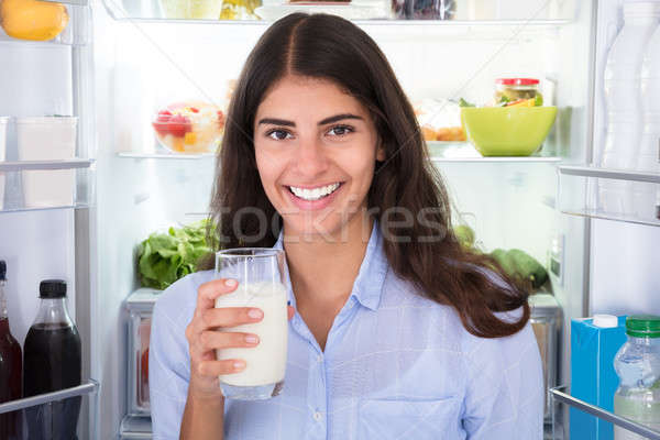 Young Woman Holding Glass Of Milk Stock photo © AndreyPopov